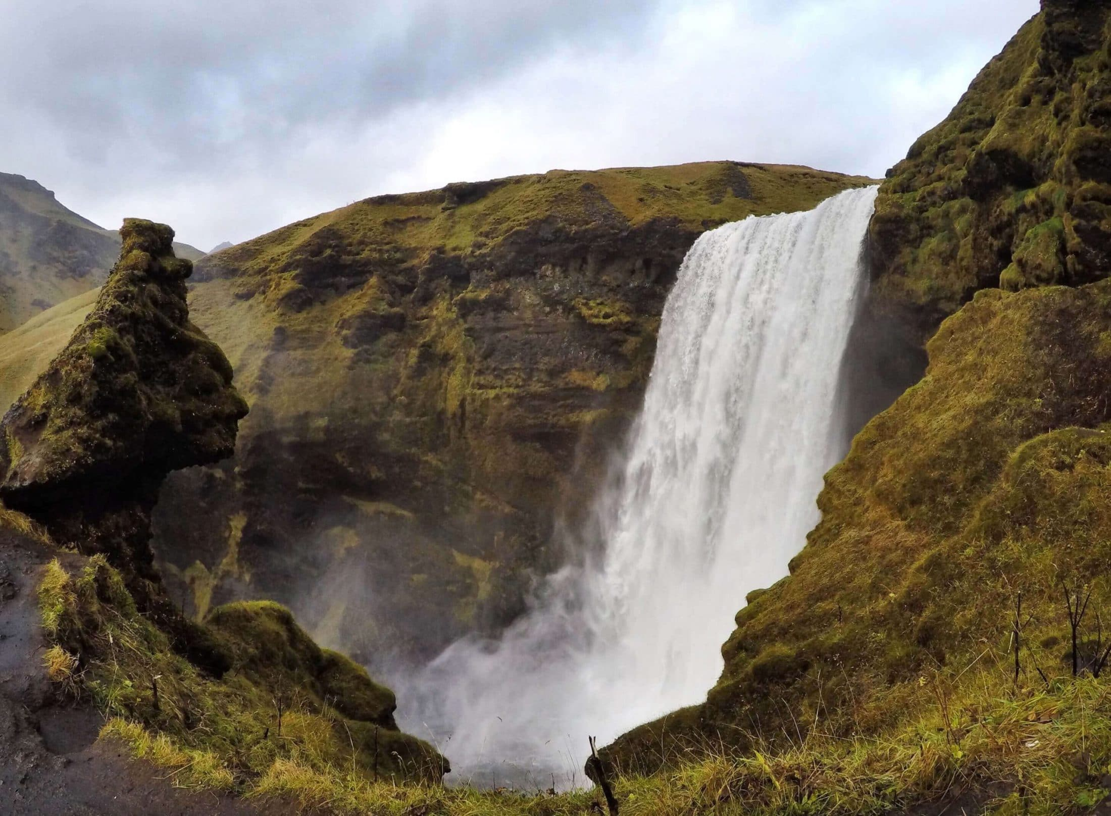Hiking to the top of Skogafoss, Iceland south coast
