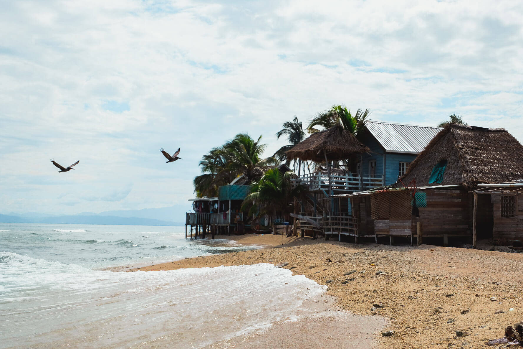 Backpackers and adventure travelers stay overnight in Garifuna village on Chachahuate Cay
