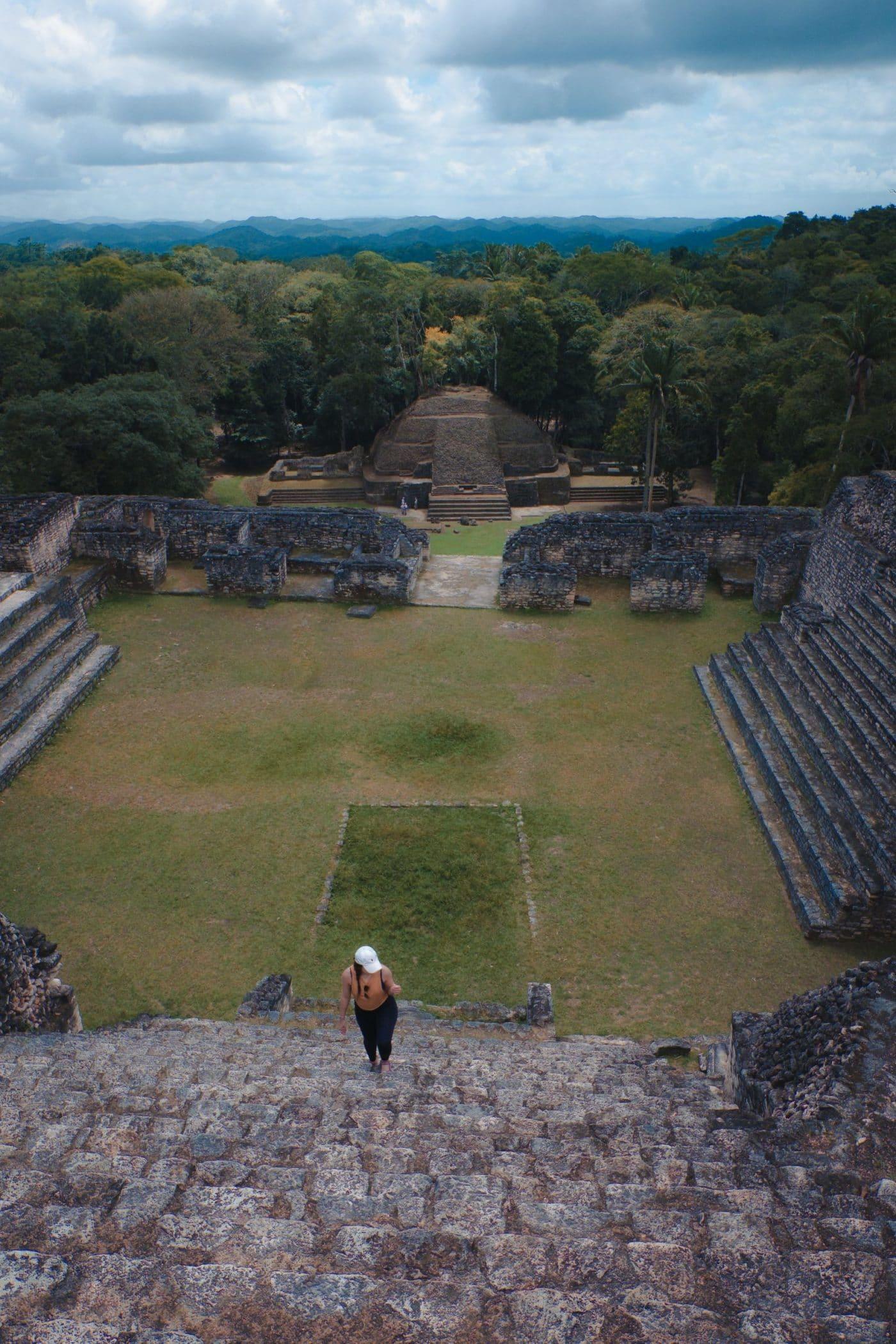 Climbing the stairs of the Mayan ruins at Caracol