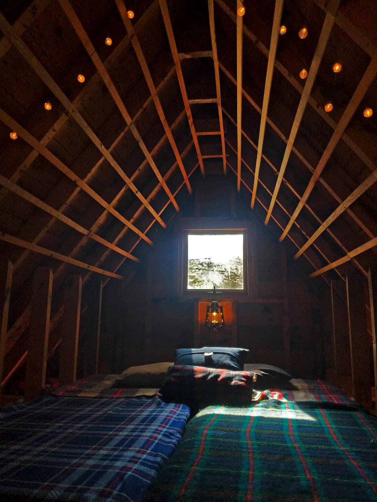 Loft bed in tiny cabin