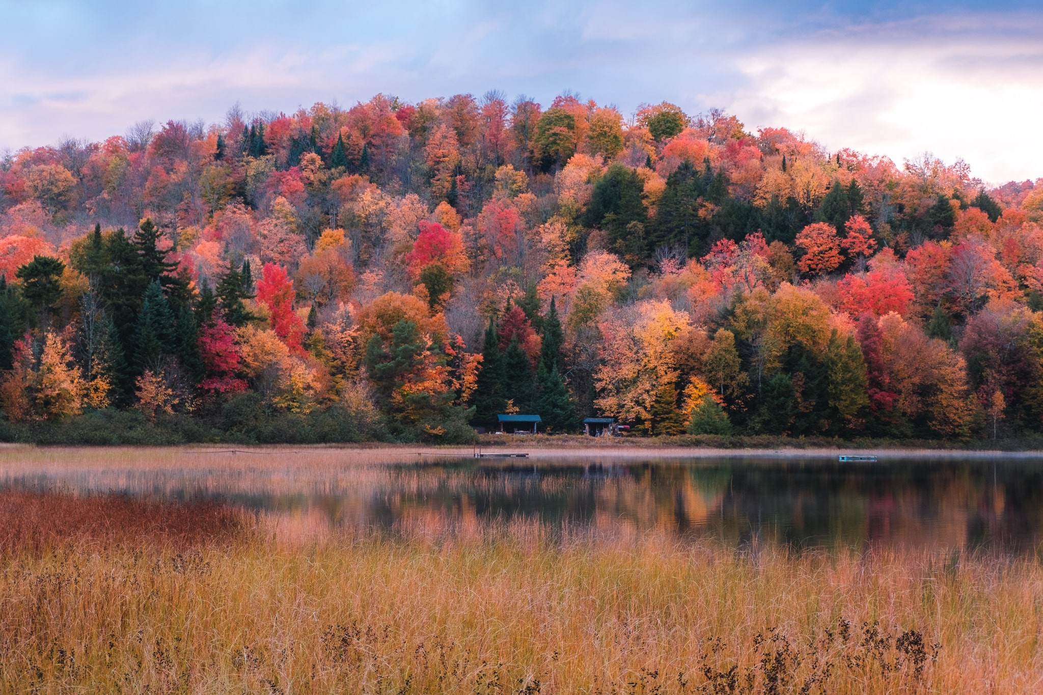 Sunset over a lake during peak foliage in New York